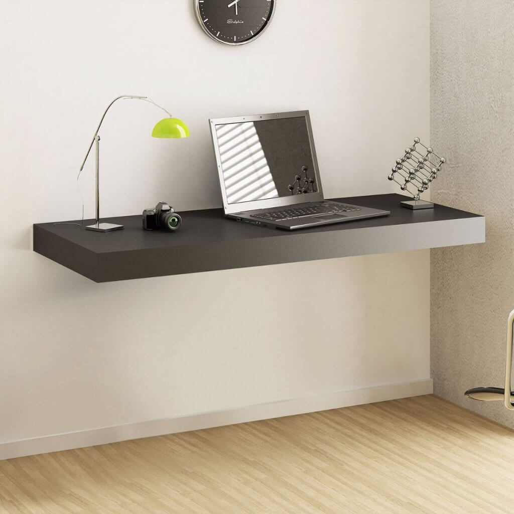 mesa suspensa com um notebook sobre ela
